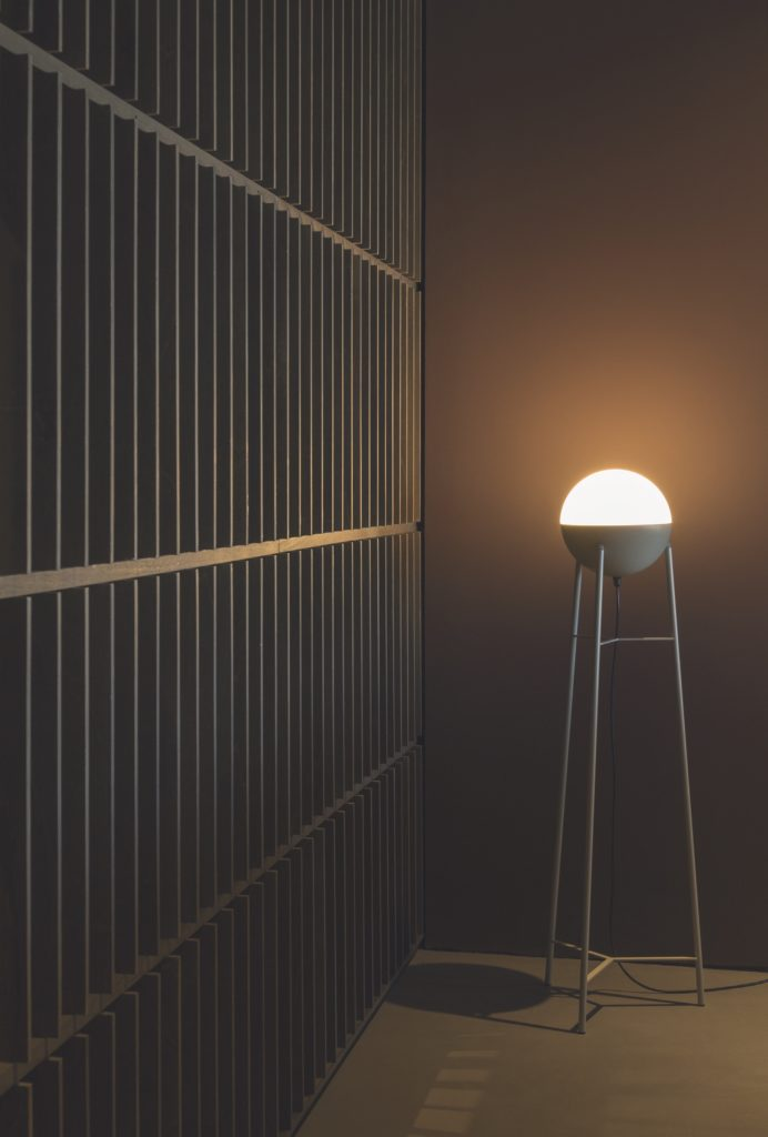 Half is an interior portable decorative lamp for residential settings
